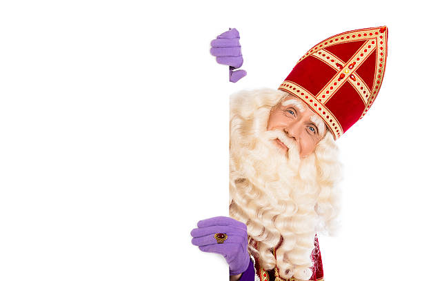 Sinterklaas with card board isolated on white Smiling Sinterklaas with white board. isolated on white background. Dutch character of Santa Claus sinterklaas stock pictures, royalty-free photos & images