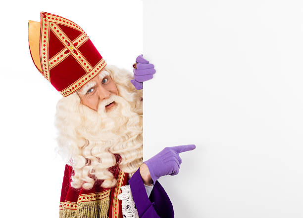Sinterklaas with placard Sinterklaas with placard. isolated on white background. Dutch character of Santa Claus sinterklaas stock pictures, royalty-free photos & images