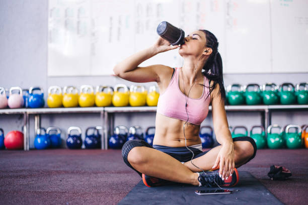 Sip of fresh water after great workout stock photo