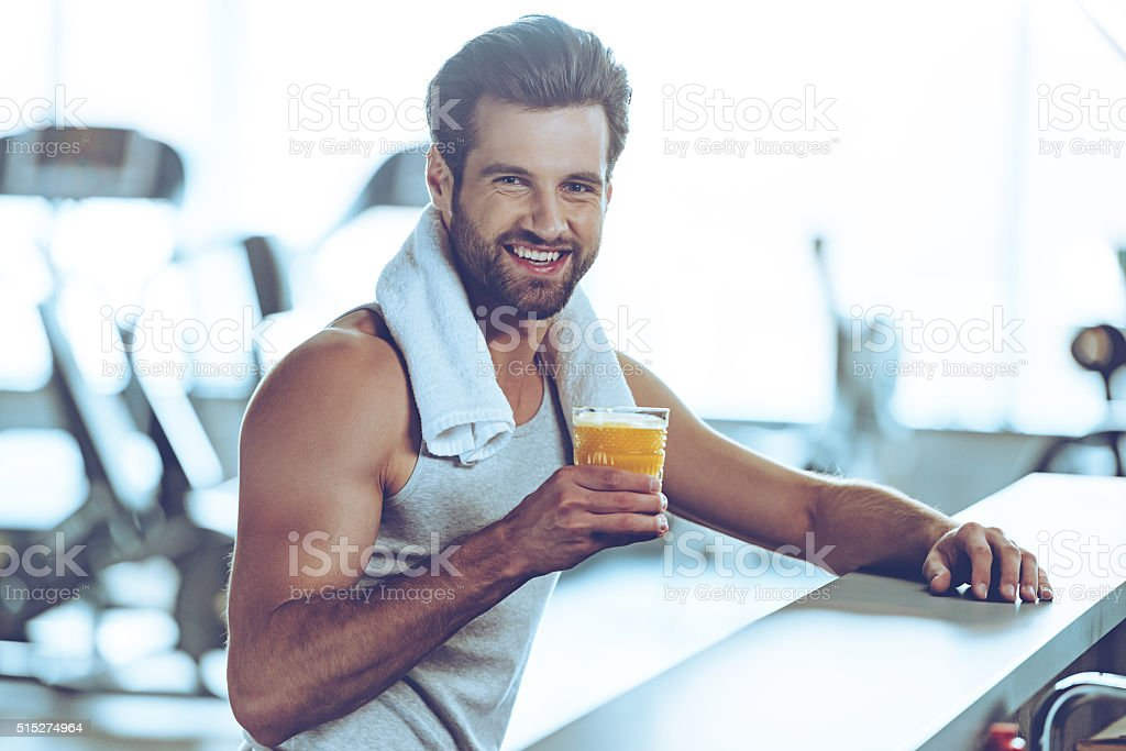 Sip of freshness after great workout. stock photo