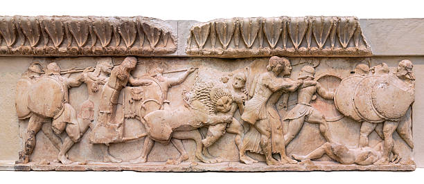 Siphnian Treasury from the Ancient Greek civilization (ca. 530 BC) Marble frieze found in the city of Delphi depicting the fight between Giants and lions along with Troy warriors. It's a very old archeological sculptural frieze depicting Greek Mythology greco roman style stock pictures, royalty-free photos & images