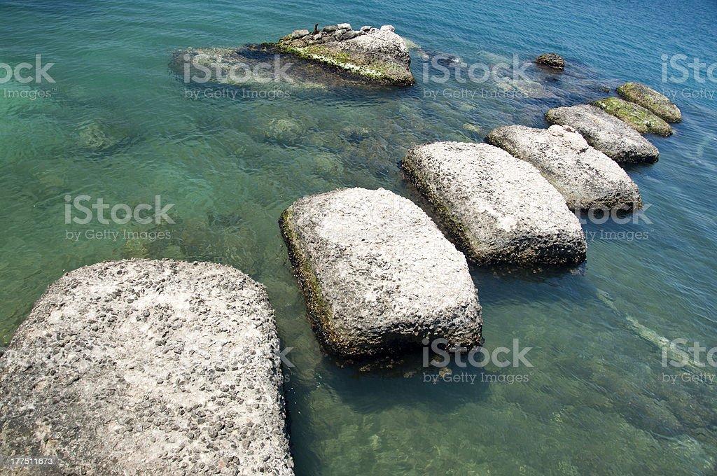 Siracusa, Sicily. Rocks in the Porto Grande stock photo