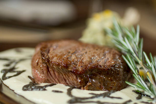 Sirloin steak in rosemary sauce tender steak over white rosemary sauce and white rice side dish. roasted prime rib stock pictures, royalty-free photos & images