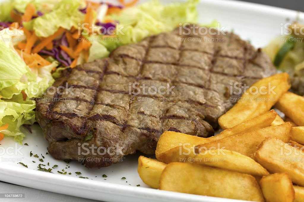 Sirloin steak with chips royalty-free stock photo