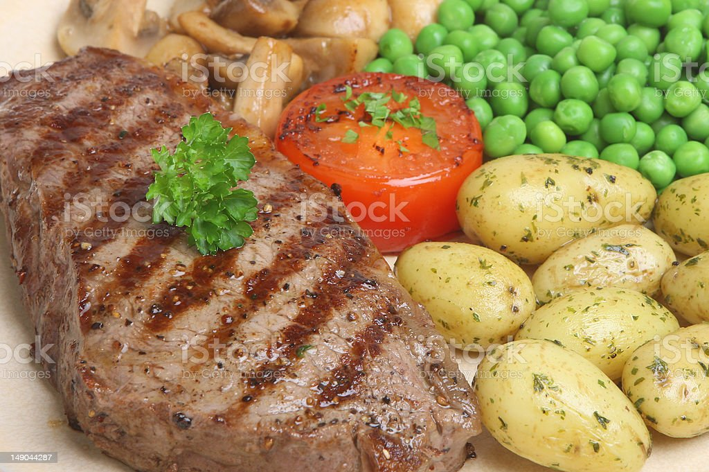 Sirloin Steak with New Potatoes royalty-free stock photo