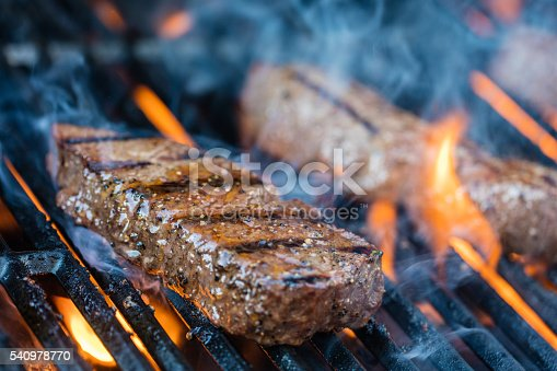 Close-up shot of two sirloin steaks on the bbq.