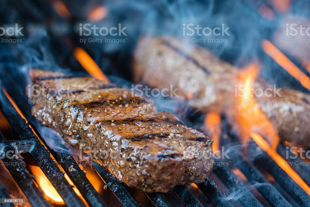 Sirloin steaks on the bbq stock photo