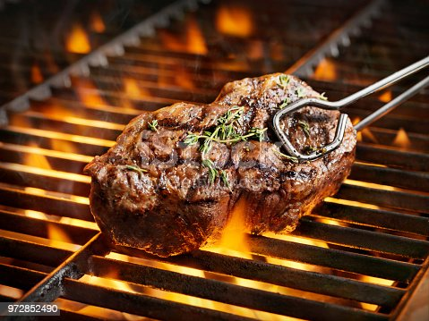 istock BBQ Sirloin Steaks with Fresh Thyme 972852490