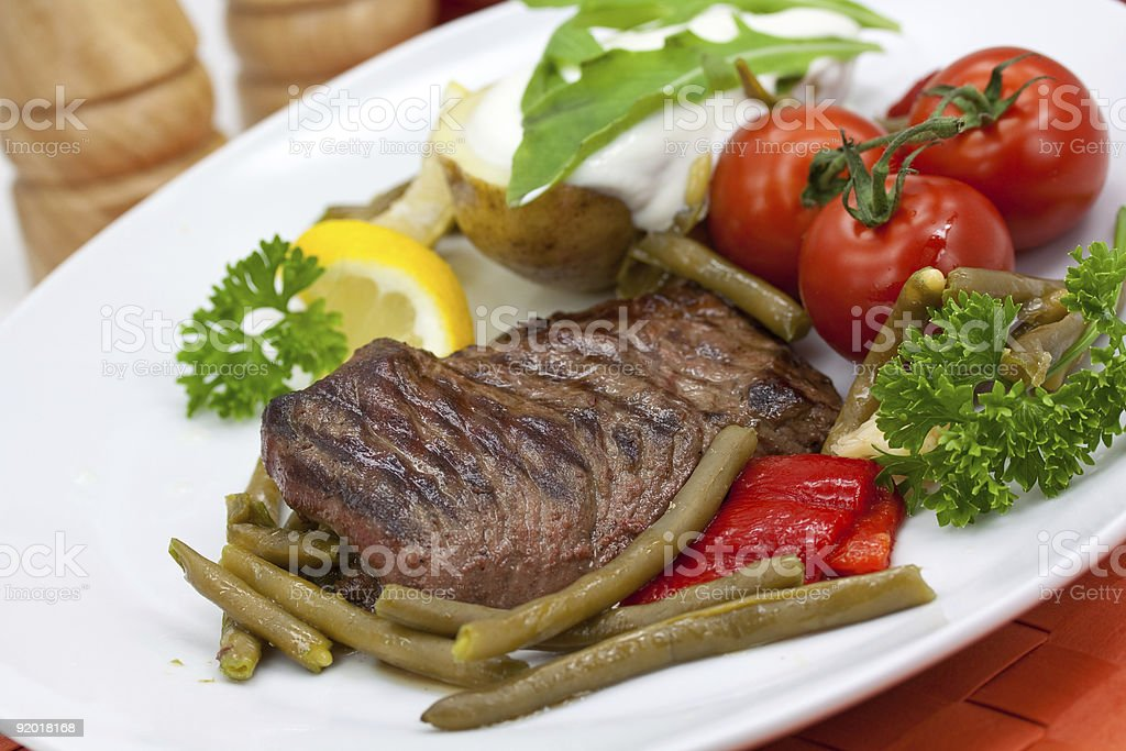 Sirloin Strip Steak with green beans,tomato,pepper royalty-free stock photo