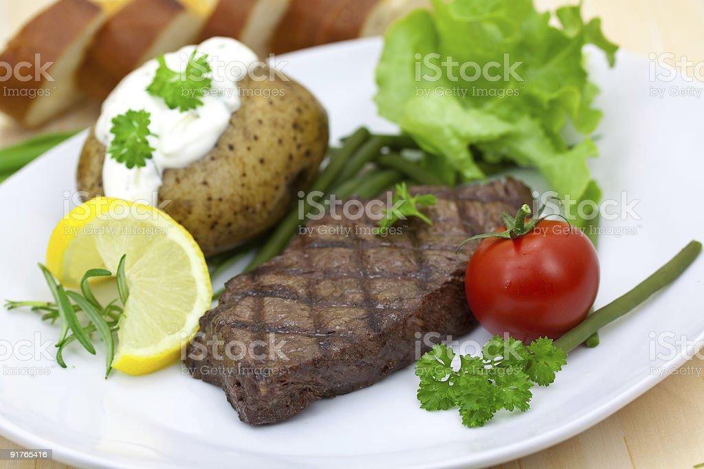sirloin strip steak with vegetables .