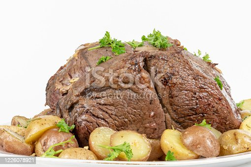 Sirloin tip roast with small potatoes