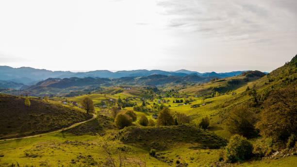 Sirnea touristic village Brasov. Bucegi mountains seen from Sirnea stock photo