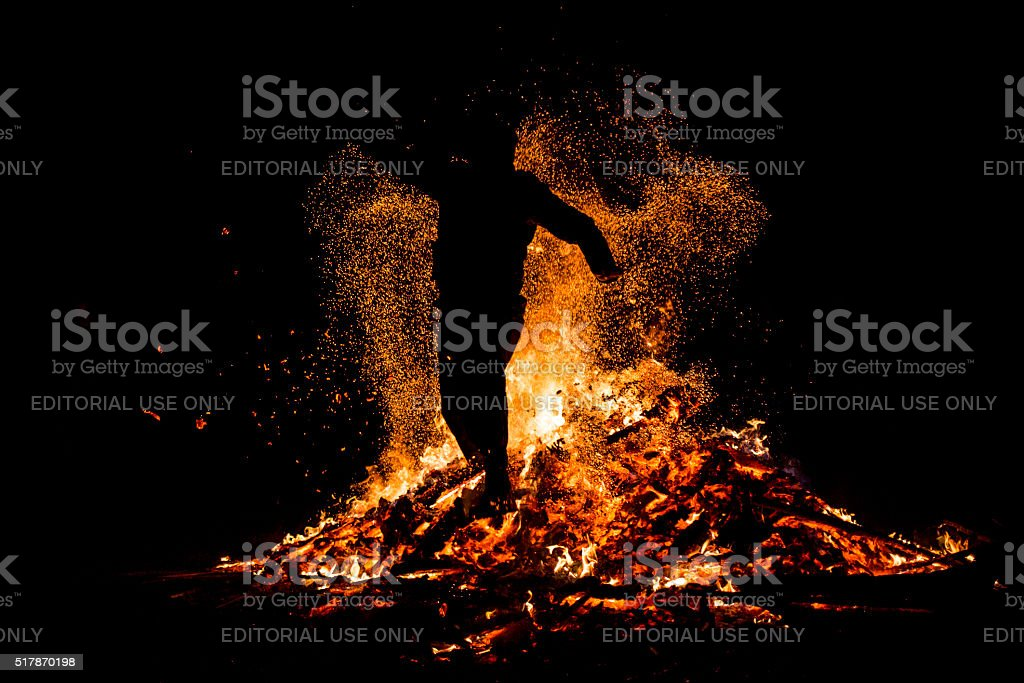 Sirni Zagovezni fire jumping stock photo