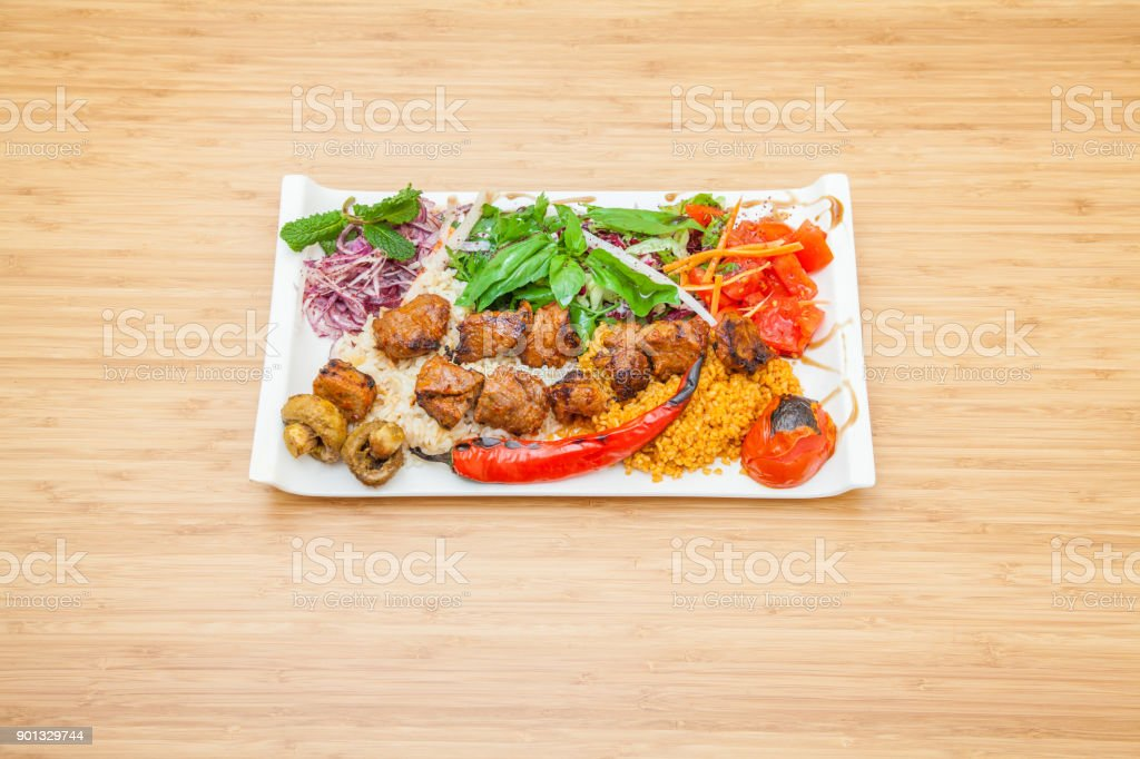 Sis Kebap with bulgur and rice - grilled special from Turkey stock photo