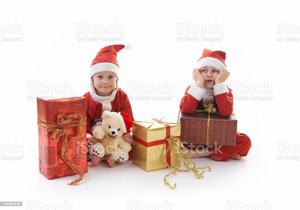 sister and brother as Santa royalty-free stock photo