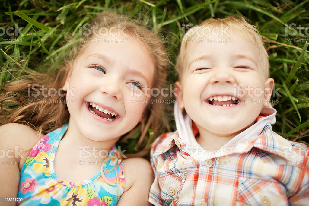 Sister and brother kids laughing. Top view. stock photo