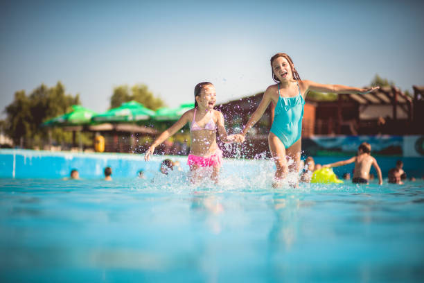 sister best friend. - children play water park stock photos and pictures