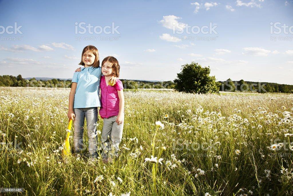 sister girls outdooors summer fun royalty-free stock photo