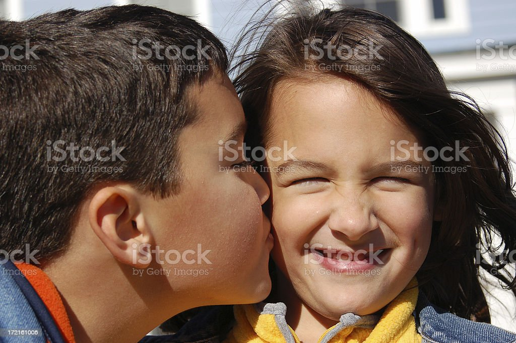 Sister hates getting kissed! stock photo