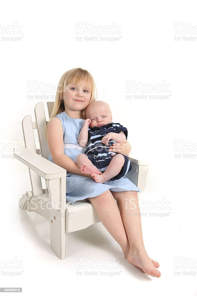 Sister Holding Her Newborn Baby Brother on White royalty-free stock photo