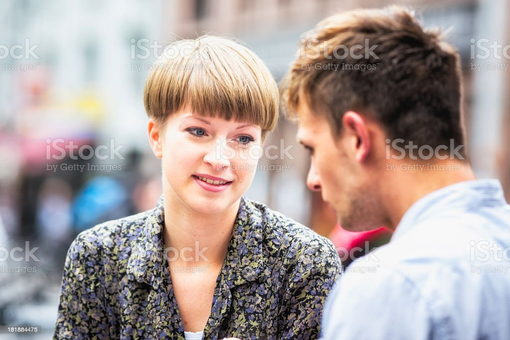 Sister lends a kind ear to her brother royalty-free stock photo