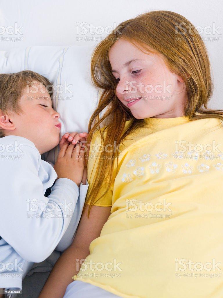 Sister looking at brother sleeping royalty-free stock photo
