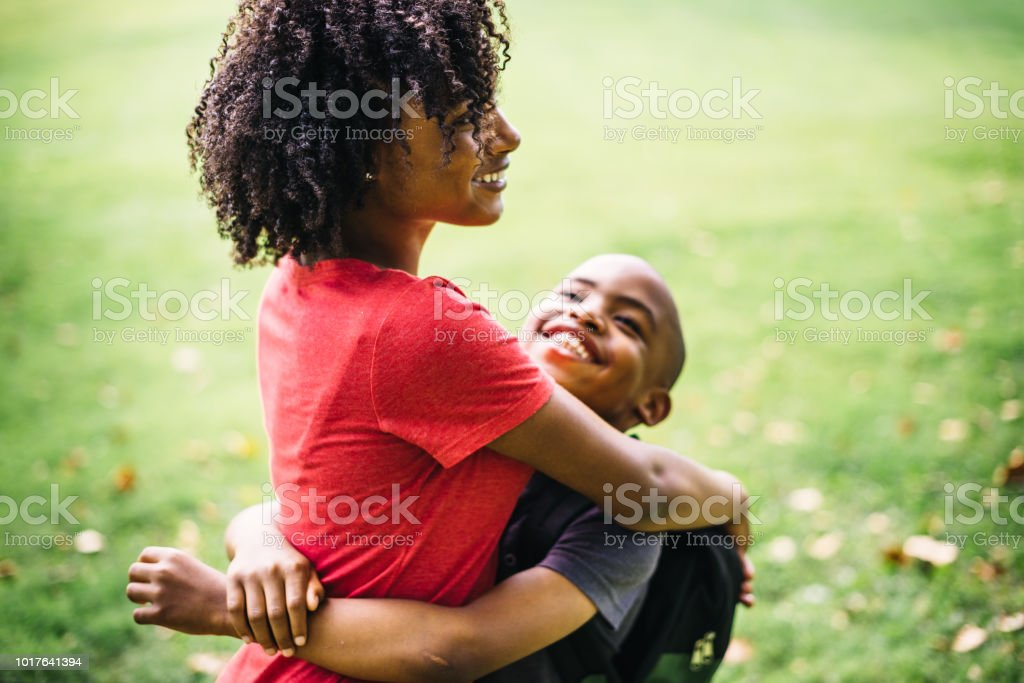 sister loves the little brother stock photo