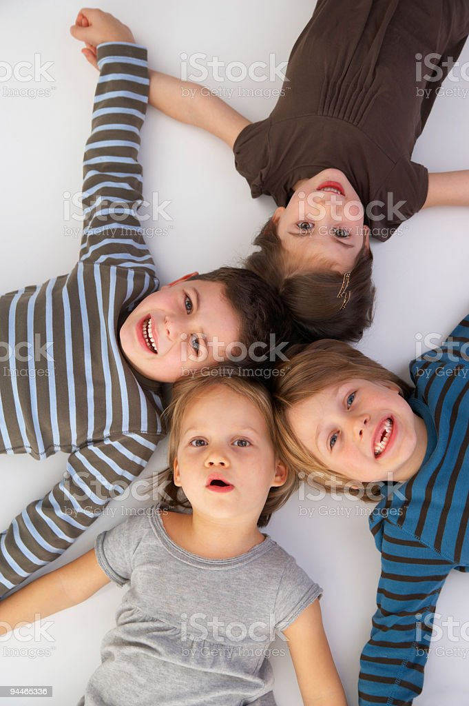 sisters and brothers laughing royalty-free stock photo