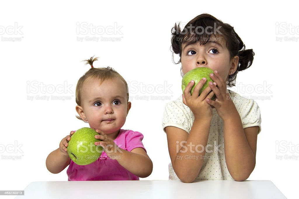 sisters eating apples stock photo