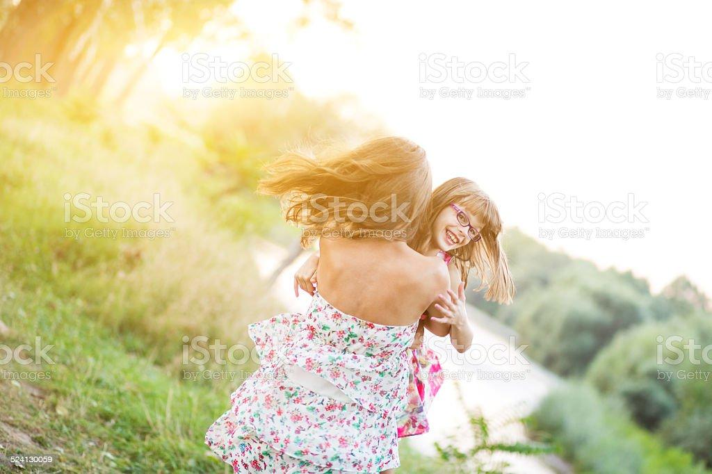 Sisters enjoy beautiful day stock photo