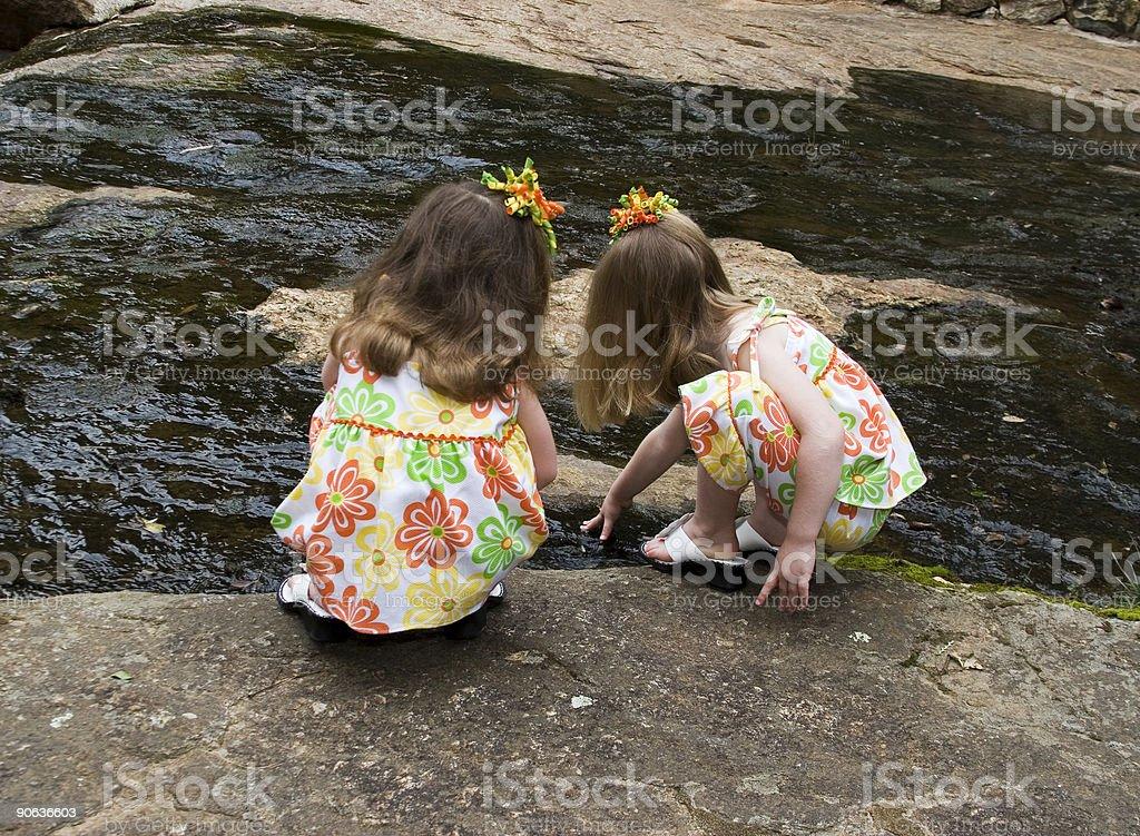Sisters exploring royalty-free stock photo