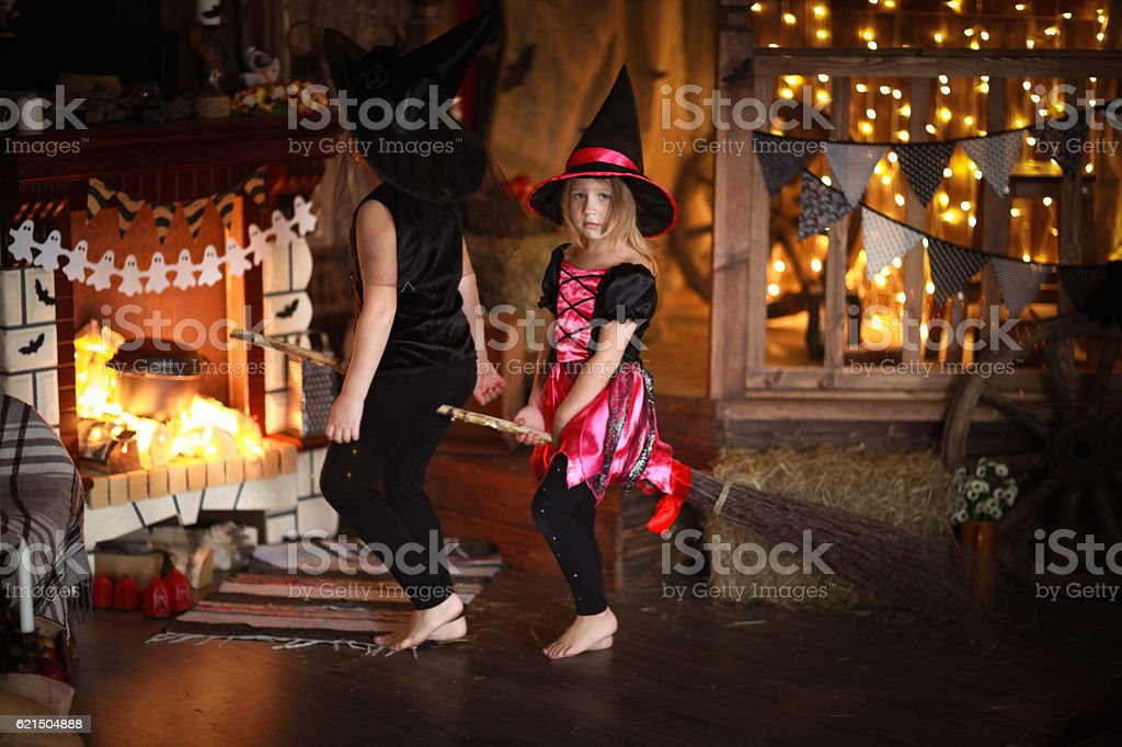 sisters Girls witch with  broom . Halloween foto stock royalty-free