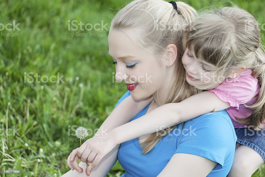 Sisters having fun in the park royalty-free stock photo