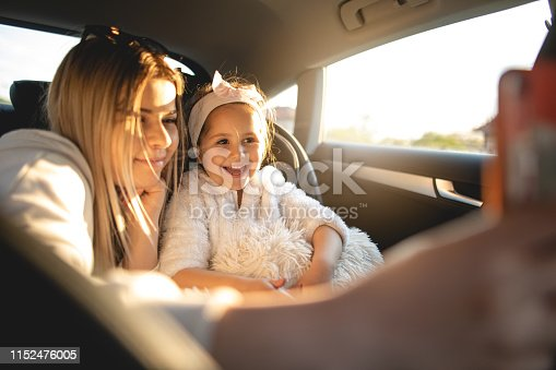 807410214istockphoto Sisters having time together on a sunny day car ride 1152476005