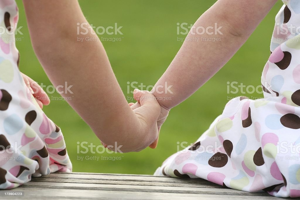 Sisters Holding Hands royalty-free stock photo