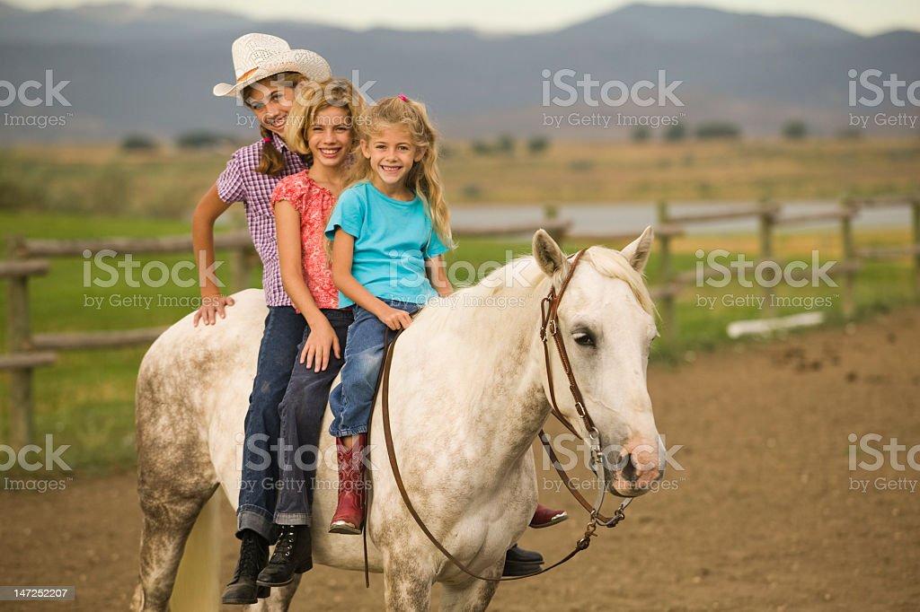 Sisters horseback riding stock photo