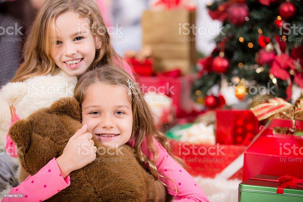 Sisters Hug Their Christmas Presents Tree Holiday Morning Family Royalty Free