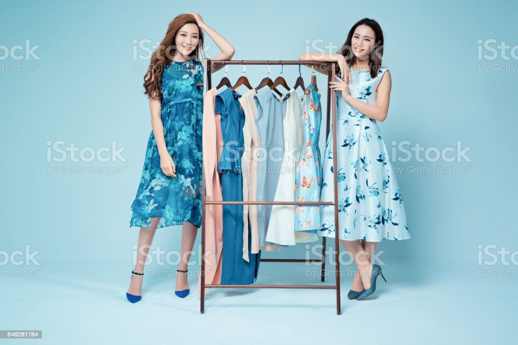 Sisters in the clothing store to buy clothes stock photo