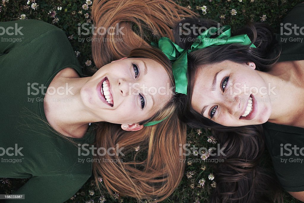 Sisters Laughing and Laying Down stock photo