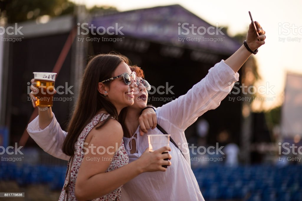 Sisters Making Selfie At Beer Festival stock photo