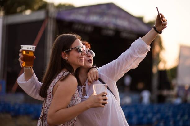 Sisters Making Selfie At Beer Festival stock photo
