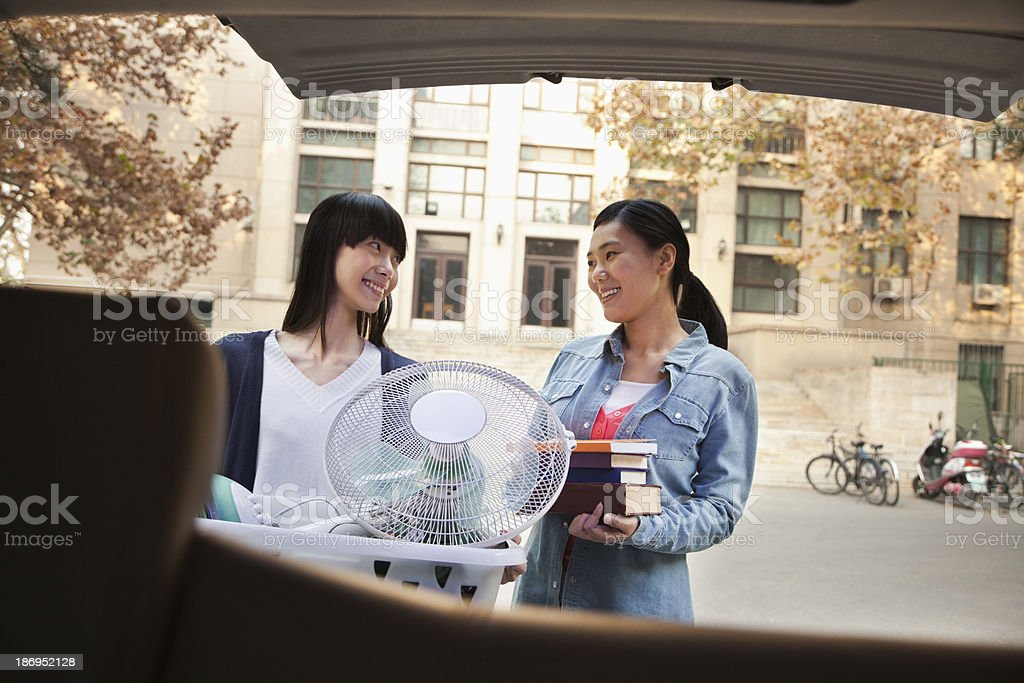 Sisters moving into dormitory at college stock photo
