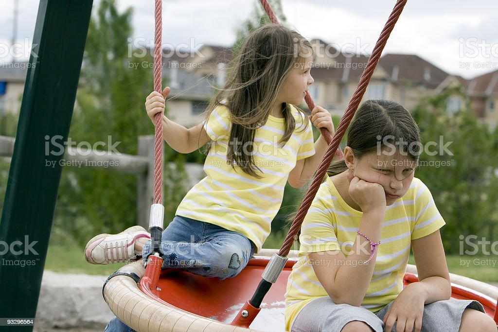 sisters on swing royalty-free stock photo