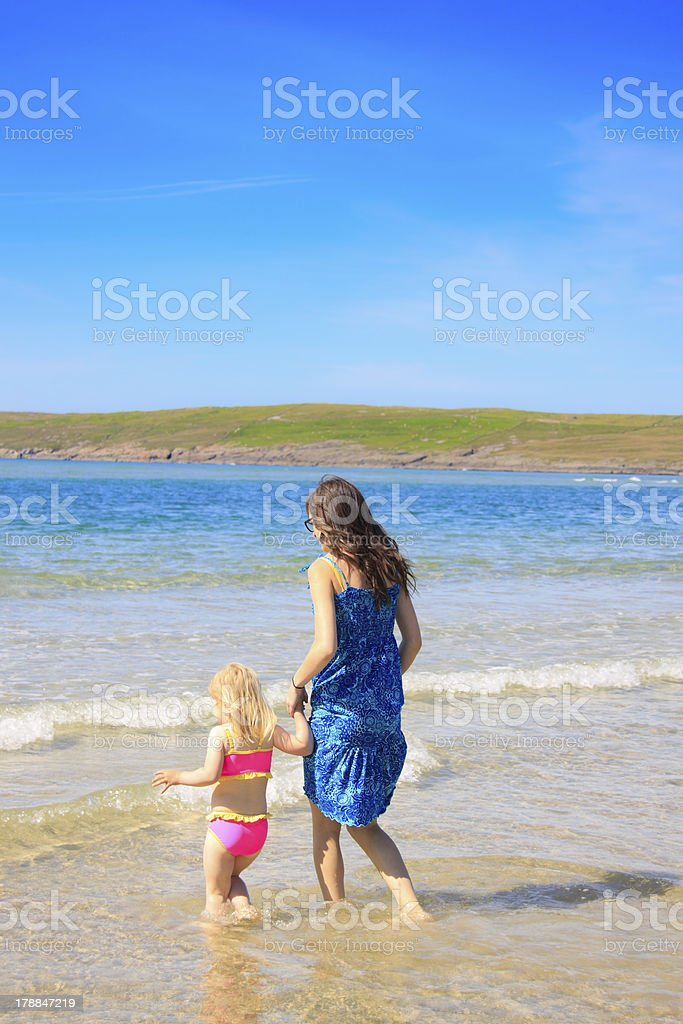 sisters on the beach stock photo