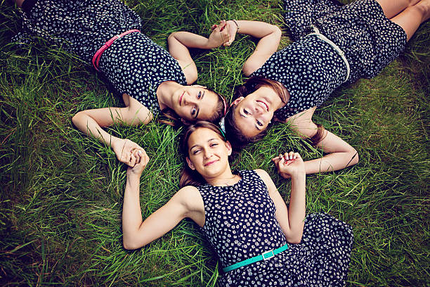 sisters - triplets stock photos and pictures
