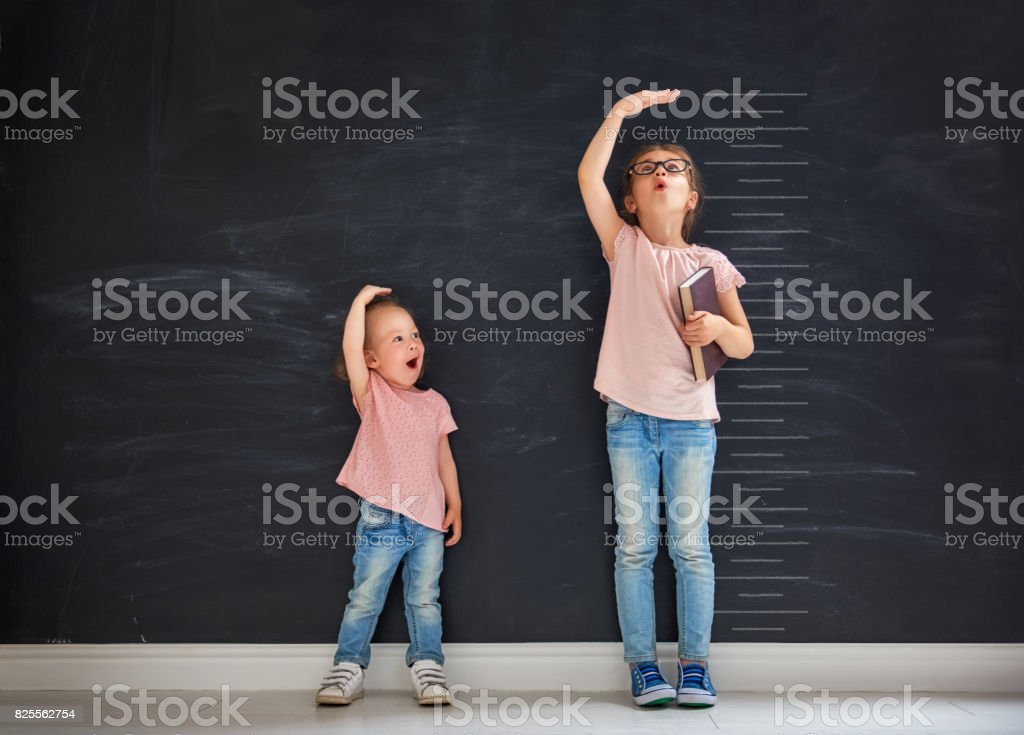 sisters play together stock photo