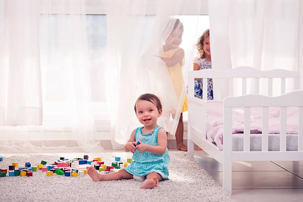 sisters playing together. - mädchenraum vorhänge stock-fotos und bilder