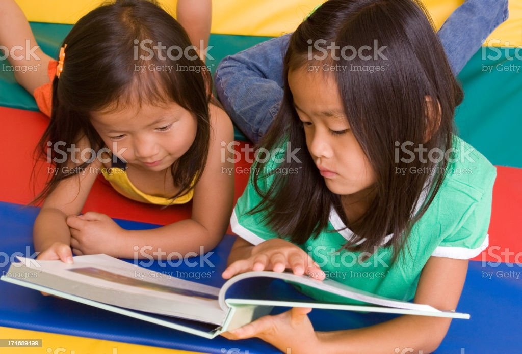 Sisters Reading Together royalty-free stock photo