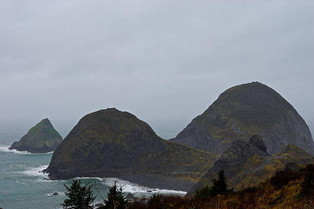 Sisters Rock Gray Sky stock photo