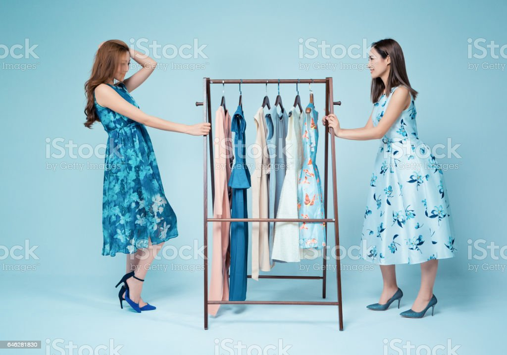 Sisters show clothes stock photo